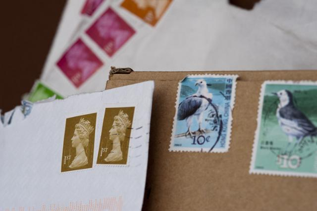 Postage stamps and envelopes